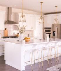 Pendant Lights In White Kitchen White Kitchen With Brass Pendant Lights Clear Acrylic Bar
