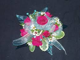 hot pink spray roses with waxflower and pitt leaves and light blue accent and light blue prom flowerswrist corsagespray