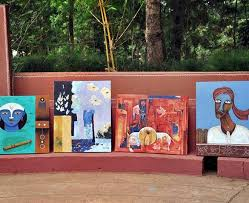 paintings by various artists from across the state that were on display at the haveri utsav