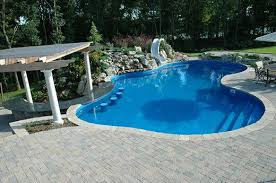 Pool designs with swim up bar Outdoor Kitchen In This Design And Build Project We Added Swim Up Bar In The Main Pool That Features Granite Countertops As Well As Inpool Bar Stools Swim Out Steps The Deck And Patio Company Swim Up Bars The Deck And Patio Company