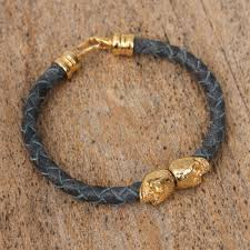 mexican skulls in blue blue braided leather 18k gold plated skull pendant bracelet
