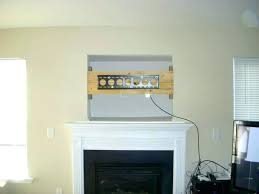 mount tv above fireplace mounting above fireplace hiding wires how to install over fireplace pics mounting
