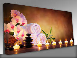 massage stones with towels and candles