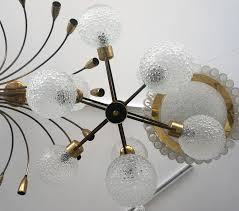 german mid century modern atomic orbital chandelier antique brass with glass globes for