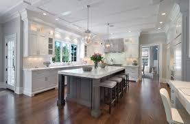 white kitchen cabinets with gray kitchen island