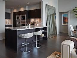 low back white modern bar stools kitchen with grey granite countertop kitchen island black cabinets recessed lights in minimalist kitchen ideas