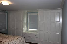built in closets around window in bedroom built in closets diy home design ideas