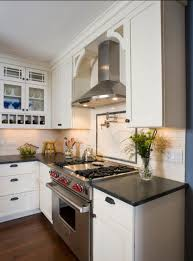 Traditional kitchen featuring white cabinetry and stainless steel appliances