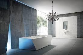 modern elegant bathroom with grey stone wall and white rectangular bathtub combined by black metal pendant