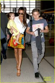 Victoria Beckham Carries Yawning Harper Through LAX Beckham s.