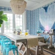 jute rug dining room blue chairs at gray wood trestle dining table jute rug