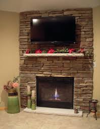 stacked stone electric fireplace heater with mantle mantel canada