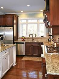 cherry kitchen cabinets with gray wall and quartz countertops ideas wood kitchen cabinets white granite