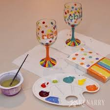great diy tutorial to learn how to make hand painted wine glasses using colorful enamel paints