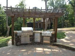 outdoor kitchens and patios designs. simple vintage outdoor kitchen patio designs using stone counter plus metal grilll wooden pergola roof kitchens and patios