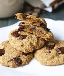 vegan and gluten free chocolate chip cookies on a plate with the top cookie broken