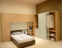 Small Bedroom Wardrobe Cool Small Bedroom Design Brown Bedside Wooden Shelves Hangers