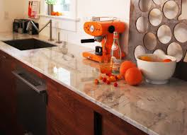 Orange And White Kitchen Using Marble For Kitchen Countertops
