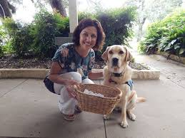 founder and executive director sarah garrett and therapy dog mabel