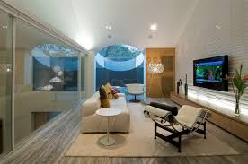 mirrored wall panel design with lcd chaise lounge in amazing living room plus moder white sofa and wall mounted tv amazing design living room