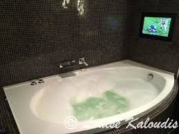 astral tower and residences spa bath with tv