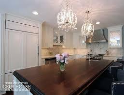 dark wood kitchen countertop for a large kitchen island in a white kitchen