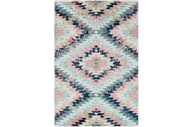 aztec style area rugs youth rug wonderland pink blue living spaces 0