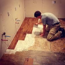 can i put vinyl tile on top of vinyl sheet flooring glue down hardwood floors on