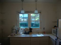 Over The Sink Kitchen Light Hanging Lights For Kitchen Dark Brown Cabinets Peach Wallpaper