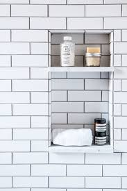 Built in shower nook, with white subway tiles and dark gray grout -- great