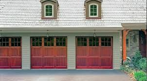 swinging garage door swinging garage doors swing out garage doors custom carriage find beautiful wood vinyl