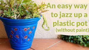 jazz up a plain plastic flower pot