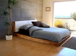 Fantastic Bed On Floor Design Using Wooden Platform Bed Also Grey Bedding  Plus White Potted Plants Plus Grey Concrete Wall Paneling