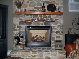 cool indoor living room fireplace decor with raised stone