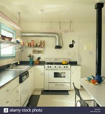 All White Kitchen Stainless Steel Extractor Pipe And White Range Oven In Modern