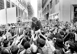 senator robert f kennedy surrounded by an enthusiastic crowd caigned in philadelphia in