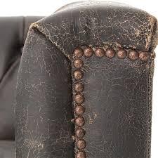 karl rustic lodge black stud tufted