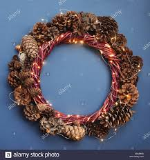 Wreath With Blue Lights Christmas Wreath Of Pine Cones And Glowing Lights Garland On