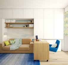 apartment decoration the fascinating modern apartment home office design in white blue brown comes with a wooden table a chair a sofa a shelving unit blue brown home office