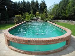 above ground swimming pool designs. Above Ground Pools Can Come With Waterfall Features. Image Source Swimming Pool Designs A