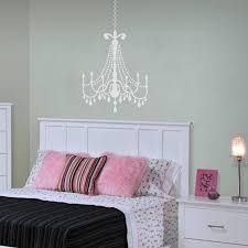medium matte white glamour chandelier on a light turquoise wall