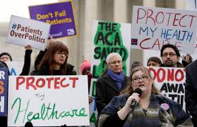 many unaware of supreme court challenge to obama s health care law laura hayes microphone of fort wayne na tells fellow protestors how