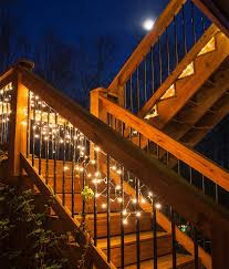 hang icicle string lights across deck railings to illuminate a backyard party