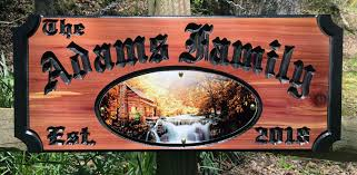 eastern red cedar wood sign with beautifully carved custom wording comes with beautiful log cabin and mountain stream scene a perfect addition to your
