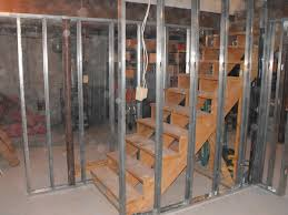 metal studs framing. metal studs to frame the stairs and partition wall in franklin basement. framing r