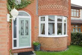 white upvc windows arched posite door