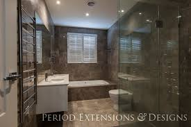 the built in bathroom tub together with shower space gives this bathroom a contemporary and functional space the details lies in the double vanity