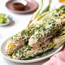 Brush corn with a layer of mayonnaise and sprinkle with chili powder,. Mexican Street Corn 2 Ways On The Cob Off The Cob Foolproof Living