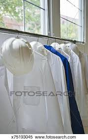 Lab Coat Rack Awesome Stock Image Of Lab Coats And Hardhats Hanging On Rack X32