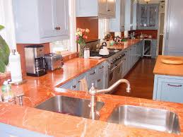 both caesarstone and quartz are resistant to heat and minor scratches you can put hot pans directly on caesarstone or quartz without damaging the material